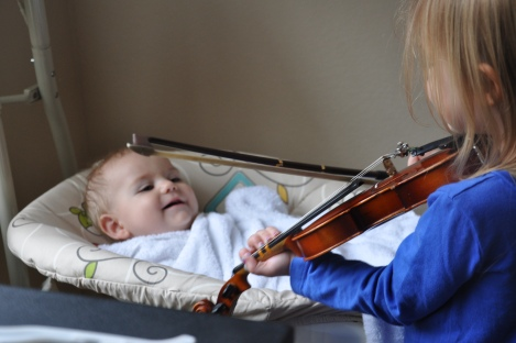 Week 42: Fiona serenading Leif. If you hear the video (which I have) it's amazing that he is smiling so much.